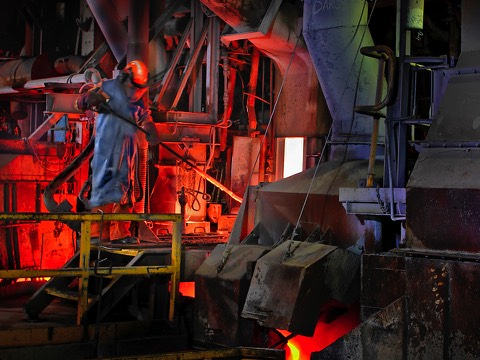 Smelter worker working furnace