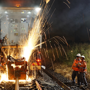 Industrial photography Auto welding on rail line at night